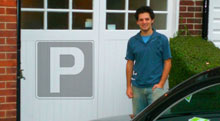 Photo of Anthony Eskinazi standing in front of a garage